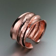 Chased T #Fold-Formed #Copper #Cuff Bracelet - Conversation piece! With its hand chased texture and spiral design, this Fold Formed Copper Cuff makes a stylish statement. Substantial but not heavy, this classic, durable bracelet is a modern-day mainstay for your jewelry collection. $165 http://www.ilovecopperjewelry.com/chased-t-fold-formed-copper-cuff-bracelet.html