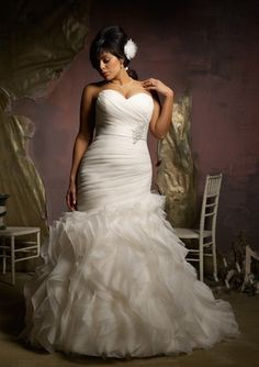 Plus size Mori Lee wedding gown.  Asymmetrical fit and flare gown with a sweetheart neckline and corset back.
