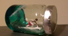 Taz Tamaki's Surfing Sculptures Surfer.in a Bottle.