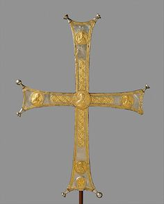 Processional Cross, ca 1000-1050. Byzantine.The donor of the cross cannot yet be connected with a historical figure.In style the work is similar to a group of processional crosses made between the 11th & 13th centuries, which have medallions on the front and niello decoration on their reverse sides.The freely wrought rinceau pattern and the elegant articulation of the figures on this example identify it as among the earliest in the series