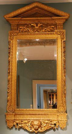 "A George II Kentian carved giltwood mirror. Ca 1730 England. 87""H x 41""W x 5""D."