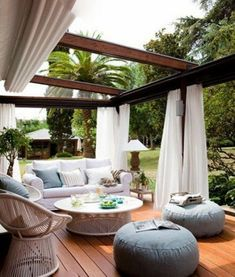 Pergola patios are a popular trend because they provide some shade and are easy to hang objects like curtains and lights from. This outdoor room gives you the homey feeling of your living room with a backyard breeze. Outdoor Rooms, Outdoor Dining, Outdoor Gardens, Outdoor Curtains, Outdoor Furniture, Sheer Curtains, Outdoor Pergola, Outdoor Seating, Outdoor Lounge