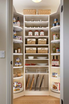 great pantry in San Marino at Woodbury. Lazy Susan side shelves and racks for cutting boards and pans. Efficient.