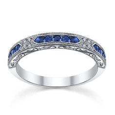 Add a touch of color on your wedding ring! This sapphire and diamond ring by Kirk Kara is perfect for your 'I Do'. Sku: 0389910