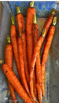 Roasted Carrots with Honey and Lemon:1 bunch of trimmed and washed carrots Olive oil Juice of 1/2 lemon 3 tablespoons honey 2 tablespoons unsalted butter - melted Kosher salt Fresh cracked pepper