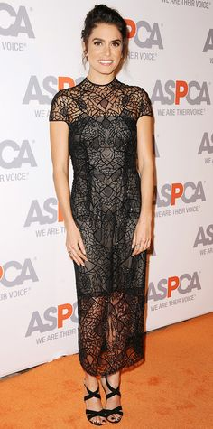 Nikki Reed smoldered at the ASPCA Compassion Awards in a black web-like embroidered sheer Monique Lhuillier dress with a gunmetal underlay, complete with strappy black sandals.
