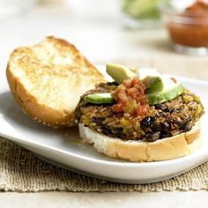 Skip the fast-food restaurant and make this burger at home to save time, money and lots of calories. Cook a veggie burger according to instructions. Using a grill pan sprayed with cooking spray, grill a thick slice of yellow onion and a Portobello mushroom cap. Place veggie burger onto half of a whole wheat hamburger bun spread with 2 teaspoons prepared pesto. Top with a slice of Swiss cheese, Portobello mushroom and onion and the second half of the bun. Serve with 2 carrots, cut into…
