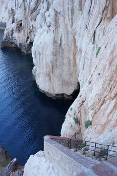 The stairs down to the Neptune Cave, Capo Caccia, Sardinia, Italy. The Gola di Gorropu Gorge is famous for being one of Europe's deepest canyons, and with its impressive white walls towering some 350 m high, walking here really is an unforgettable experience.