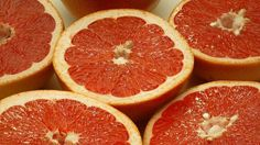 The next time you go out for cheeseburgers and fries or pepperoni pizza, you might want to consider washing it down with a glass of grapefruit juice.