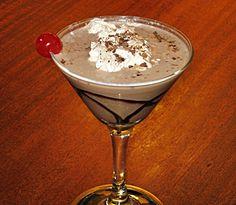 Boston Cream Pie Martini (1.5 oz. Vanilla Vodka 1.5 oz. Chocolate Liqueur 1.5 oz. Baileys Irish Cream 1.5 oz. Half & Half Chocolate Syrup Dollop of Whipped Cream Chocolate shavings Cherry)