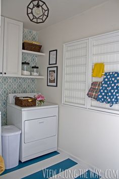 See how Kelly from View Along the Way transformed here laundry room and get a behind the scenes look at her photo shoot on Style Spotters: http://www.bhg.com/blogs/better-homes-and-gardens-style-blog/?socsrc=bhgpin052213juneididit