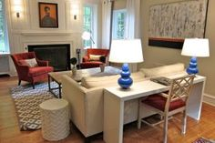 put a desk behind the couch to add an office space to a living room, ideas for small spaces More