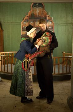 The man is wearing a bunad from Valdres. The woman is wearing a bunad from Nord- Trondelag, and the baby wrapped in swaddling clothes. Norway Culture, Historical Clothing, Folk Clothing, Scandinavian Embroidery, Folk Costume, My Heritage, People Around The World, Folklore, Finland