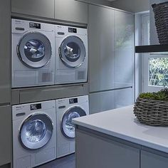 Gray Lacquered Laundry Room Cabinets with Two Sets of Washers and Dryers, Modern, Laundry Room