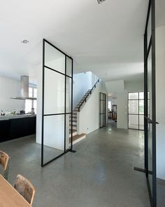 I'm kinda in the mood for some interior inspiration this Saturday afternoon. Dreaming of black framed windows and doors in my future home.