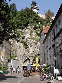 Schlossberg, Austria... These stairs climb the hill up to a beautiful public garden and its clock tower.