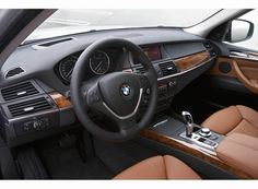 Love the cinnamon brown interior on this BMW X5, so classy and sophisticated.