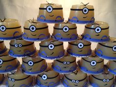 Applesauce birthday treat minions! Used the store brand applesauce since the container surface was smooth. Fairly quick work with a hole punch, marker, black floss, blue/black construction paper and quite a few glue dots!