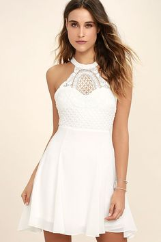 You'll be lookin' fine sipping lemonade in the Made in the Crocheted White Skater Dress! Crocheted lace covers a sweetheart bodice with a halter neckline that fastens at back with hook clasps. Strappy accents frame a sultry open back, while a flaring, woven poly skater skirt falls below. Hidden back zipper/clasp.