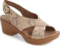 Dansko Women's Shoes in Taupe Snake Leather Color. Sleek, crisscrossed leather straps top a stylish sandal featuring a super-lightweight sole and a dual-density footbed with built-in arch support for signature Dansko comfort.