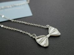 SALE Silver Bow Necklace Silver charm necklace Cute necklace Bow tie necklace Gift mom Gift best friend Birthday presents Gift sister. $18.00, via Etsy.