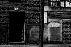 """Immediately south of downtown St.Louis along South Broadway begins the warehouse district where I found """"Warehouse 104."""" These old warehouses, many built in the late 1800′s with their typical red brick design, now serve multi-purposes as apposed to originally be storage for the garment and automotive industry which were quite active in St.Louis. Their deep textures in both the brick and old glass windows I believe made for a great subject."""