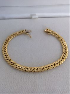 A personal favorite from my Etsy shop https://www.etsy.com/listing/270219350/18k-solid-heavy-gold-vintage-link