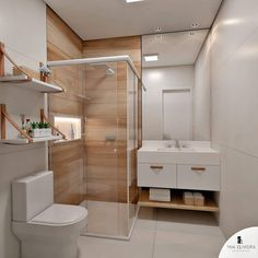 Lindo banheiro com porcelanato que imita madeira no bom! Adorei as prateleiras também! 🥰❤️✨ Projeto Yan Oliveira Interiores . Conheça…
