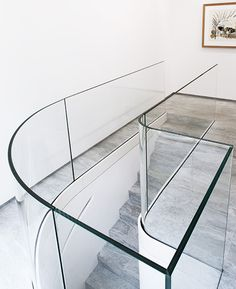 Curved glass staircase railing // Pierre Yovanovitch Architecture d'Intérieur