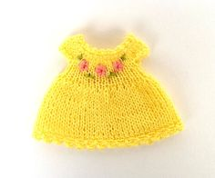Hey, I found this really awesome Etsy listing at https://www.etsy.com/listing/234766030/miniature-hand-knitted-yellow-dress-for