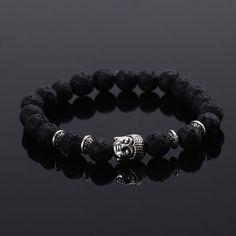 Très beau, bracelet fantaisie femme ou homme en perles de lave noires, Bouddha argent, élégant, il est le bijou à adopter sans attendre! Véritable accessoire de mode. Facile à mettre et à enlever, 17 à 24 cm de Ø. Très agréable à porter.