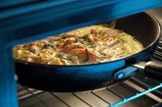 """Eggs, Oyster Mushrooms, Bacon/Ham, Onions, Basil, Thyme, Jalepeno Jack cheese.    Finishing the cooking via our toaster oven (about 10""""x12"""" interior). I have to say, I'm surprised and very very pleased with how this toaster oven has become our oven, si"""