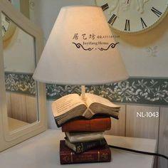 Risultati immagini per lampadario DIY con libri vecchi