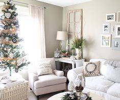 Use Fabric Details: By nature, a living room is meant to be a special place to relax and spend time with family and friends. Get the look by layering a collection of old and new fabric-wrapped details -- things like soft upholstered seating, linen drapes, and pillows. Finish with framed holiday family photos, greenery tucked into vases, and a decked out Christmas tree arranged in a place of honor.