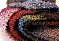 This rustic knit scarf pattern is a great garter stitch project to try this season. The Fruits of the Forest Scarf is a beautifully colored scarf full of earth tones, deep reds, rich purples, and moss greens.