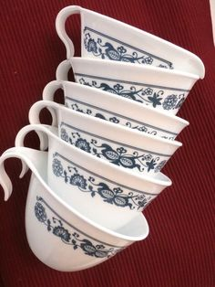 """Here's a set of 5 stackable cups with hook handles and 1 creamer in the Corelle Old Town blue and white pattern. Cups and creamer are 4"""" high and 2.25"""" wide. Works great in a small kitchen space or if you need unbreakable kitchenware."""