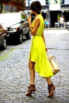 gorgeous bright yellow chartreuse flowing sleeveless high-low dress paired with some strappy neutral stilettos