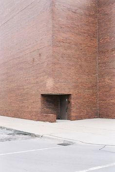 Almost the sound of a hollow in space. The interior is whispering and the form curls around space. Would you describe this as a corner, an entrance? This is the face of a building and one can feel the blind stillness watching.