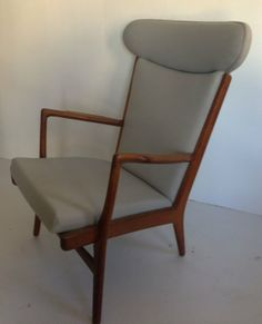 """Sold for $3,000 in June 2013.  Hans Wegner teak and upholstery lounge chair and ottoman. The stool interestingly enough is signed Fritz Hansen. Chair found in Literature: Hans J. Wegner's 100 Chairs, Oda, pg. 58. The Chair measures 40"""" tall x 30"""" wide x 31"""" deep. And the ottoman measures 16.5"""" tall x 18.25"""" long x 14.25"""" wide."""