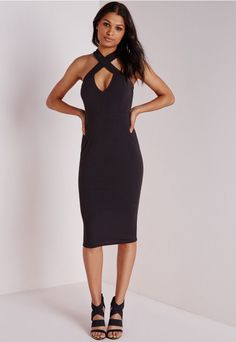 Channel major chic vibes in this black midi dress. With fierce cross front neckline this dress will give you a standout silhouette. Team with black lace up heels and box clutch for a luxe finish.