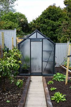 Compact on size . . . Big on quality and performance.    Size (LxWxH): 120 x 189 x 230cm    At 4′ x 6′ Trulux Mini is our smallest glasshouse.    Packed with Trulux features and ready for serious growing.    Feel free to call us to discuss your greenhouse requirements.