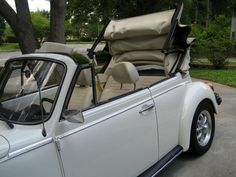 I want to drive away from my wedding in this car.....<33 1977 triple white VW Beetle convertible