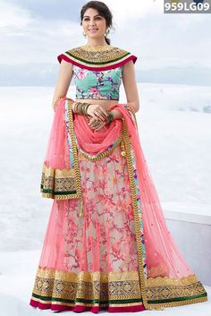 Pink net lehenga highlighted with floral printed linling. The neckline and hemline detalied with zari, resham embroidery, stone, sequins, dori and gota patti work. Light Blue art silk choli and pink net dupatta are available with this.Price US$ 164