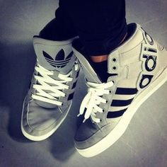 grey Adidas high tops.