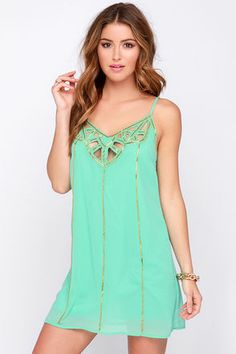 Set sail in the Cutout to Sea Mint Beaded Dress and know that you're donning the hottest look of the season! Skinny adjustable spaghetti straps support a triangle bodice with a chic, cutout front and back trimmed with shiny gold beads, that also run down the sheath bodice. Breezy mint poly Georgette offers a light and playful look. Fully lined in mint satin. 100% Polyester. Dry Clean Only. Imported.