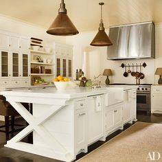 Decorator Suzanne Kasler designed this all-white Atlanta kitchen, maximizing counter and storage space.