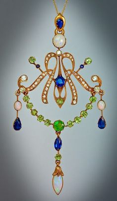 Jeweled Art Nouveau Gold Pendant for Sale. Russian c. 1900, with diamonds, sapphires, opals, and demantoid garnets