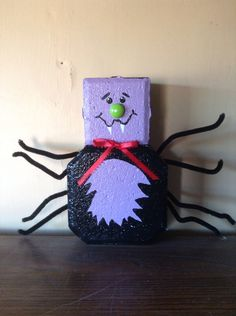 I painted a spider on a keyhole paver.