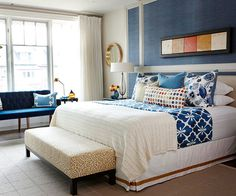 Blue accent wall in master with white linens