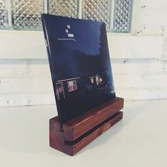 Now Playing Wooden Record Display Stand Display the vinyl jacket of the record that is Now Playing on your turntable with this beautiful stand.